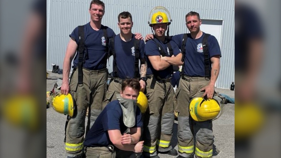 Sean Whyte (pictured wearing the helmet) and some of his course mates as he prepares to fulfill his dream of becoming a firefighter (Supplied).