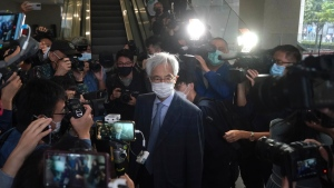 Pro-democracy activist Martin Lee, centre, arrives at a court in Hong Kong Friday, April 16, 2021. (AP Photo/Kin Cheung)