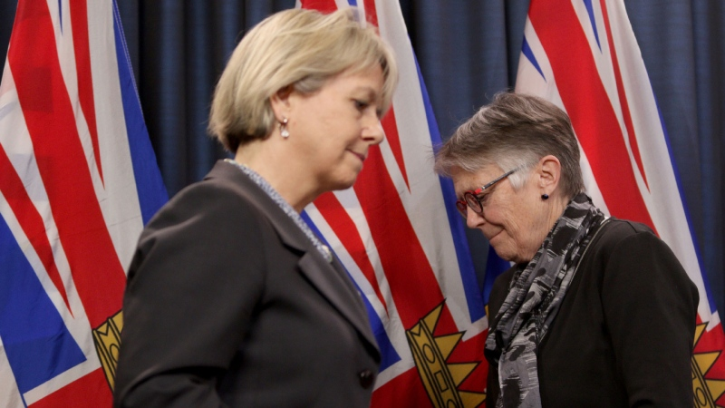 Dr. Bonnie Henry and Dr. Penny Ballem take turns at the podium as they talk about phase two in B.C.'s COVID-19 immunization plan at Legislature in Victoria, B.C., on Monday, March 1, 2021. THE CANADIAN PRESS/Chad Hipolito