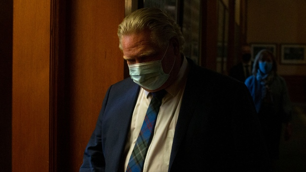 Ontario Premier Doug Ford makes his way back to his office after a news conference at the Queens Park Legislature in Toronto on Wednesday, April 7, 2021. THE CANADIAN PRESS/Chris Young
