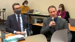 In this image from video, defense attorney Eric Nelson, left, and defendant, former Minneapolis police officer Derek Chauvin address Hennepin County Judge Peter Cahill during motions before the court Thursday, April 15, 2021, in the trial of Chauvin, at the Hennepin County Courthouse in Minneapolis. (Court TV via AP, Pool)