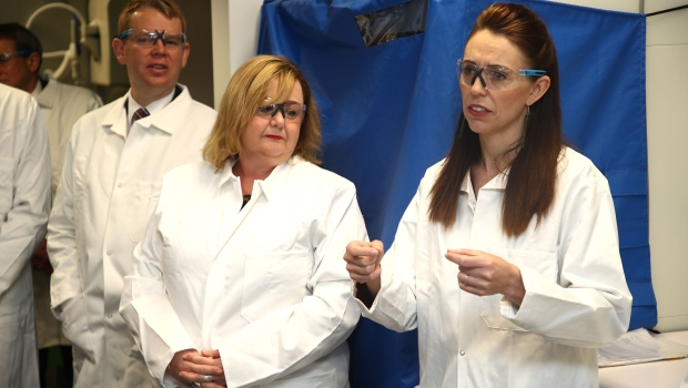 New Zealand Prime Minister Jacinda Ardern (right) and Megan Woods, Minister of Research, Science and Innovation, visit a lab at Auckland University. (Phil Walter/Getty Images via CNN)