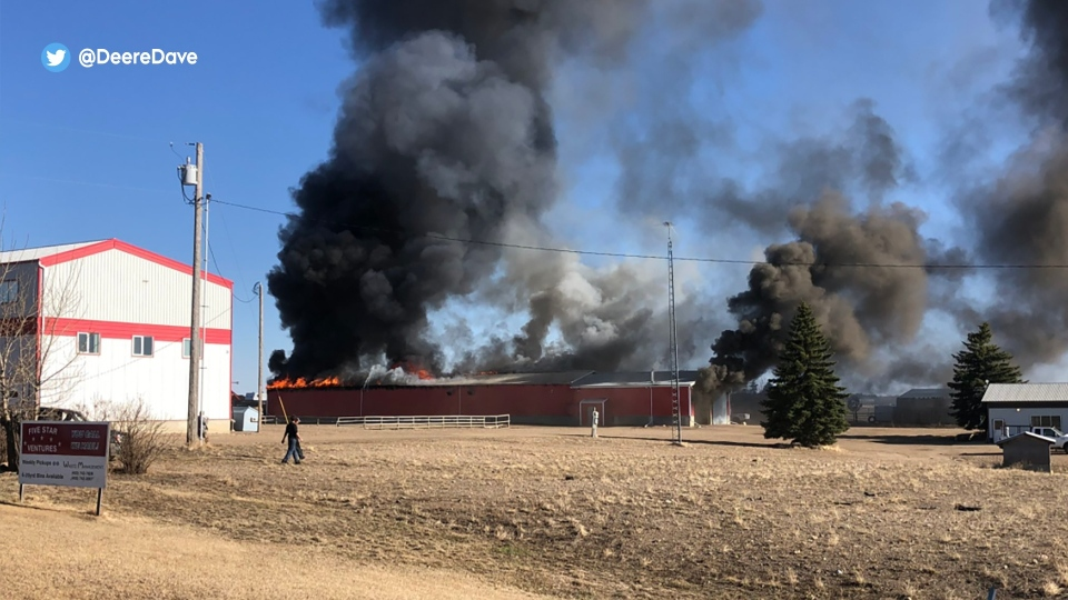 Images from the fire at Stettler's Five Star Ventures Waste Management facility (Supplied/Twitter/DeereDave).