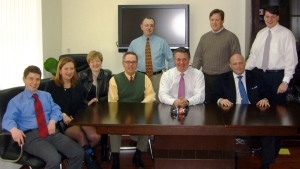 Konstantin Kilimnik, an elusive figure under indictment for alleged witness tampering by Special Counsel Robert Mueller, is seen seated on the far left in a March 2006 photo obtained by The Associated Press as part of a collection of internal corporate memos and business records from the international political consulting offices of Donald Trump's ex-campaign chairman, Paul Manafort. (AP Photo)