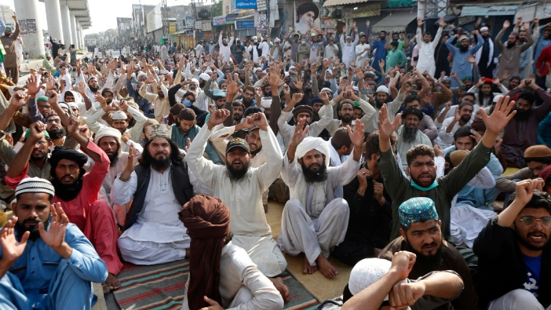 Supporters of Tehreek-e-Labiak Pakistan, a radical Islamist political party, chant slogans during a protest against the arrest of their party leader, Saad Rizvi, in Lahore, Pakistan, on April 15, 2021. (K.M. Chaudary / AP)