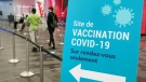 People walk into a COVID-19 vaccination clinic in Montreal, on Thursday, April 15, 2021. THE CANADIAN PRESS/Paul Chiasson