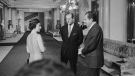 In this undated image provided by The Richard Nixon Library & Museum, Queen Elizabeth II and her husband Prince Philip talk with U.S. President Richard Nixon at Buckingham Palace in London. (The Richard Nixon Library & Museum via AP)