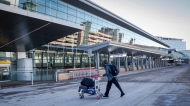 A lone traveler enters the Calgary Airport in Calgary, Alta., Monday, Feb. 22, 2021. THE CANADIAN PRESS/Jeff McIntosh