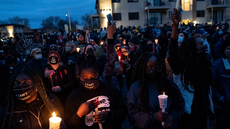 Demonstrators take part in a protest near the Brooklyn Center Police Department over Sunday's fatal shooting of Daunte Wright during a traffic stop, Thursday, April 15, 2021, in Brooklyn Center, Minn. (AP Photo/John Minchillo)