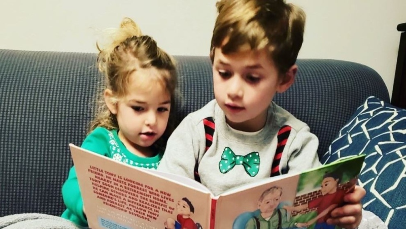 Children reading 'Tony's New Friend'.