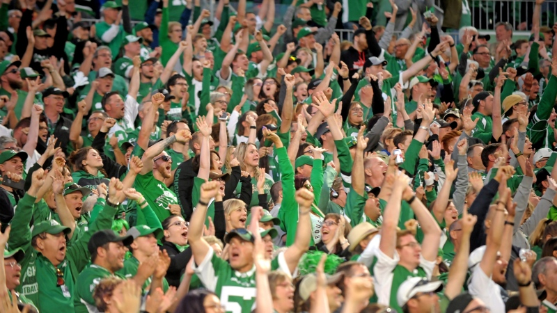 Saskatchewan Roughriders fans celebrate defensive back Nick Marshall's pick six during second half season opener CFL action against the Toronto Argonauts at Mosaic Stadium in Regina on Friday, June 15, 2018. THE CANADIAN PRESS/Mark Taylor