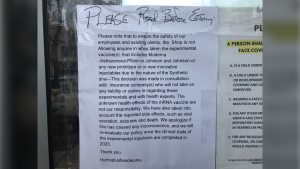 Sign on the front door of Herbs Plus Beadworks located on Ottawa Street in Windsor, Ont. on Friday, April 16, 2021. (Alana Hadadean/CTV Windsor)