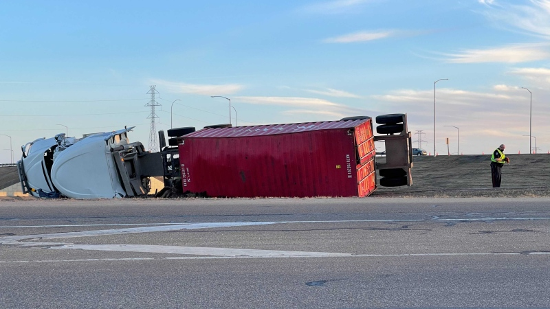 A semi-truck and its trailer rolled over near the northwest leg of the Anthony Henday Friday, April 16, 2021 (CTV News Edmonton/Sean McClune).