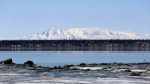 Mount Susitna, which is also known as Sleeping Lady, is shown Friday, April 16, 2021, on the other side of Cook Inlet from downtown Anchorage, Alaska. (AP Photo/Mark Thiessen)