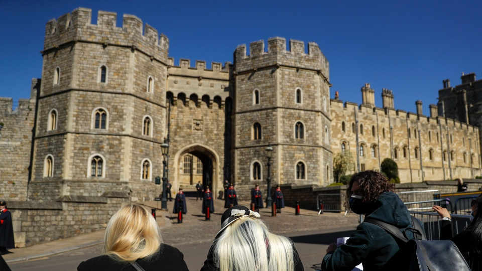 People wait ahead of the funeral of Prince Philip in Windsor, England Saturday April 17, 2021. (AP Photo/Matt Dunham)