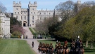 King's Troup Royal Horse Artillery rides towards Windsor Castle in Windsor, Saturday, April 17, 2021. Prince Philip, husband of Queen Elizabeth II, died Friday April 9, aged 99, his funeral service takes place at Windsor Castle in St George's Chapel. (AP Photo/Frank Augstein)