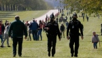 Police patrol the Long Walk leading to Windsor Castle, Windsor, England, Saturday, April 17, 2021, ahead of Prince Philip's funeral. (AP Photo/Frank Augstein)
