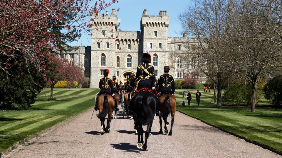 Officers of The King's Troop Royal Horse Artillery arrive for the Gun Salute for the funeral of Prince Philip at Windsor Castle in Windsor, England Saturday, April 17, 2021. Prince Philip died April 9 at the age of 99 after 73 years of marriage to Britain's Queen Elizabeth II. (Phil Noble/Pool via AP)