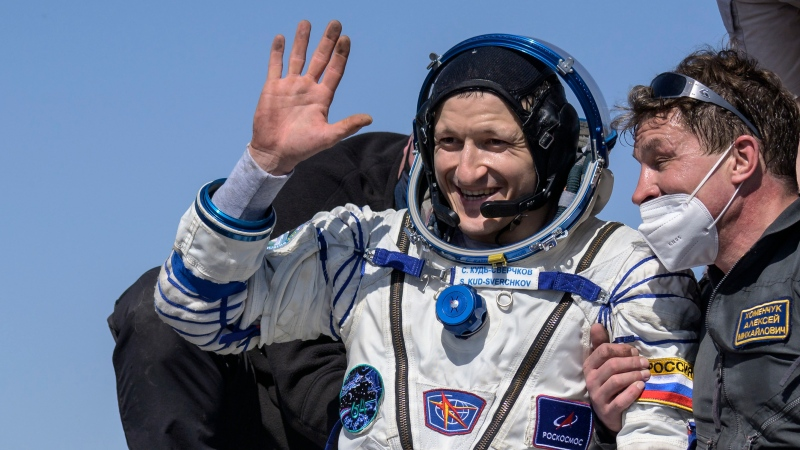 In this photo provided by NASA, Roscosmos cosmonaut Sergey Kud-Sverchkov is helped out of the Soyuz MS-17 spacecraft just minutes after he, Roscosmos cosmonaut Sergey Ryzhikov, and NASA astronaut Kate Rubins landed in a remote area near the town of Zhezkazgan, Kazakhstan on Saturday, April 17, 2021. (Bill Ingalls/NASA via AP)