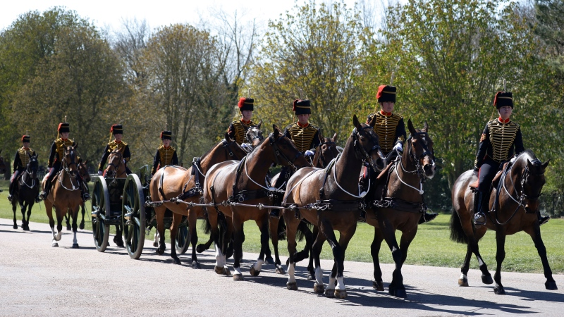 Officers of The King's Troop Royal Horse Artillery arrive for the Gun Salute for the funeral of Britain's Prince Philip at Windsor Castle in Windsor, England Saturday, April 17, 2021. Prince Philip died April 9 at the age of 99 after 73 years of marriage to Britain's Queen Elizabeth II. (Phil Noble/Pool via AP)