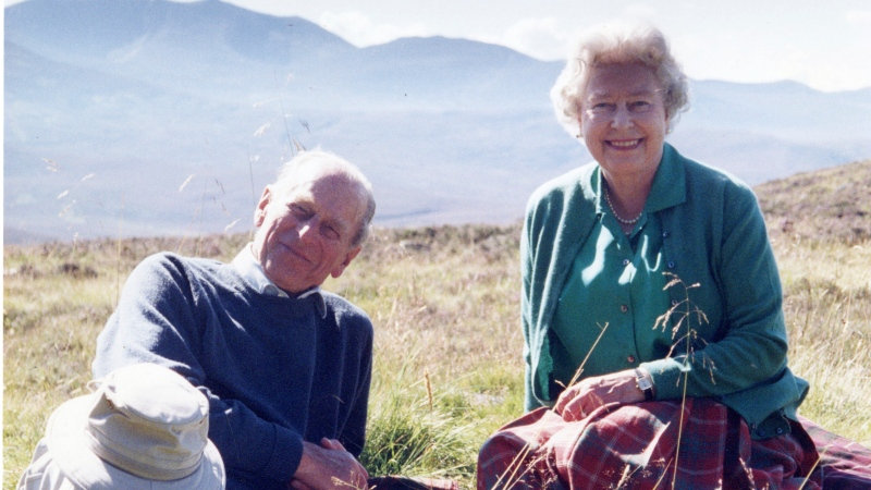 In this 2003 photo released by Buckingham Palace Friday April 16, 2021, a personal photograph of Queen Elizabeth II and Prince Philip Duke of Edinburgh at the top of the Coyles of Muick, Scotland, in this photo taken by Sophie The Countess of Wessex in 2003. (The Countess of Wessex/Buckingham Palace via AP)