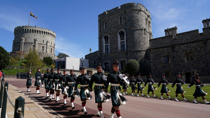 Members of the military march outside Windsor Castle, in Windsor, England, Saturday April 17, 2021, during the funeral of Britain's Prince Philip. Prince Philip died April 9 at the age of 99 after 73 years of marriage to Britain's Queen Elizabeth II. (Victoria Jones/Pool Photo via AP)