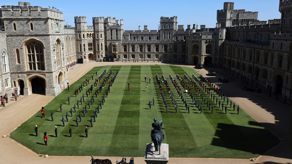 Members of the military are gathered in the Quadrangle at Windsor Castle in Windsor, England, Saturday, April 17, 2021 ahead of the funeral of Prince Philip. Prince Philip died April 9 at the age of 99 after 73 years of marriage to Britain's Queen Elizabeth II. (Adrian Dennis/Pool via AP)