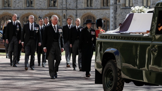 From front left, Prince Charles, Princess Anne, Prince Andrew. Prince Edward, Prince William, Peter Phillips, Prince Harry, Earl of Snowdon and Tim Laurence follow the coffin in a ceremonial procession for the funeral of Prince Philip inside Windsor Castle in Windsor, England Saturday April 17, 2021. Prince Philip died April 9 at the age of 99 after 73 years of marriage to Queen Elizabeth II. (Alastair Grant/Pool via AP)