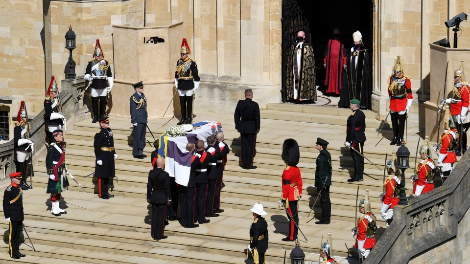 The coffin arrives at St George's Chapel for the funeral of Prince Philip inside Windsor Castle in Windsor, England, Saturday, April 17, 2021. Prince Philip died April 9 at the age of 99 after 73 years of marriage to Queen Elizabeth II. (Justin Tallis/Pool via AP)