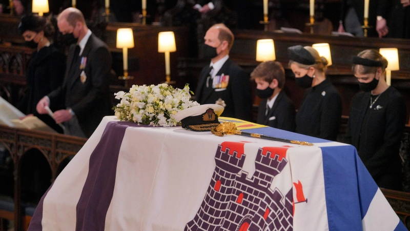 Mourners including, front row from left, Kate, Duchess of Cambridge, Prince William, Prince Edward, Viscount Severn, Lady Louise Mountbatten-Windsor, and Sophie, Countess of Wessex, during the funeral of Prince Philip, at St George's Chapel in Windsor Castle, Windsor, England, Saturday April 17, 2021. Prince Philip died April 9 at the age of 99 after 73 years of marriage to Queen Elizabeth II. (Dominic Lipinski/Pool via AP)