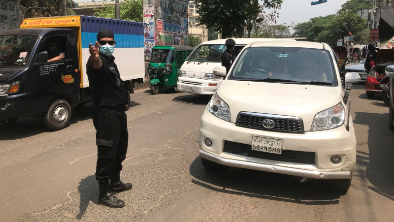 Bangladeshi police stop and check vehicles as they enforce a lockdown in Dhaka, Bangladesh, Monday, April 5, 2021. (AP Photo/Al-emrun Garjon)