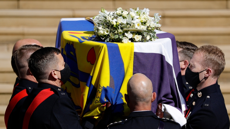 The coffin arrives at St George's Chapel for the funeral of Prince Philip inside Windsor Castle in Windsor, England, Saturday, April 17, 2021. (Kirsty Wigglesworth/Pool via AP)