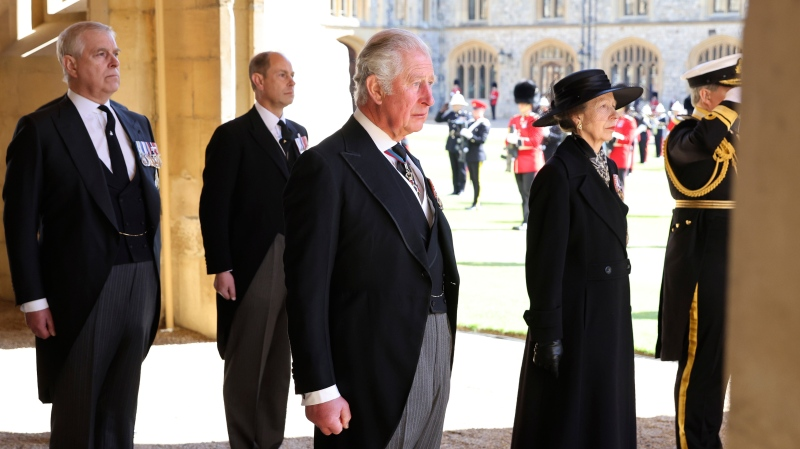 From left, Prince Andrew, Prince Edward, Prince Charles and Princess Anne arrive after walking in a procession behind the coffin of Prince Philip, with other members of the Royal family during the funeral of Britain's Prince Philip inside Windsor Castle in Windsor, England, Saturday, April 17, 2021. (Chris Jackson/Pool via AP)