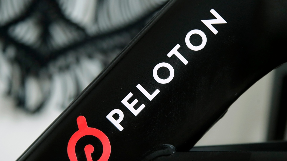 This Nov. 19, 2019 file photo shows a Peloton logo on the company's stationary bicycle in San Francisco. (AP Photo/Jeff Chiu, File)