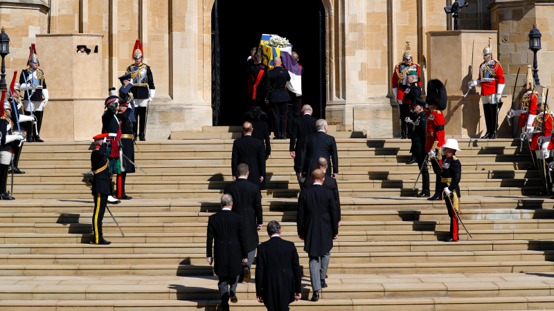 Members of the Royal Family follow as the coffin is carried inside the St. George's Chapel for the funeral of Britain's Prince Philip inside Windsor Castle in Windsor, England, Saturday, April 17, 2021. (Kirsty Wigglesworth/Pool via AP)