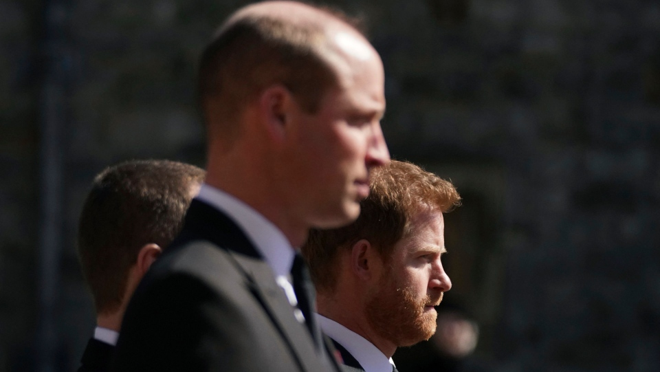 Prince William, the Duke of Cambridge and Prince Harry walk in the procession, ahead of Britain Prince Philip's funeral at Windsor Castle, Windsor, England, Saturday April 17, 2021. (Victoria Jones/Pool via AP)