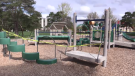 Basil Grover park in London, Ont. playground equipment is taped off, seen on Saturday April 17, 2021 (Brent Lale/CTV News)