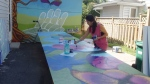 Claudia Salguero working on one of her murals. (Dave Charbonneau/CTV News Ottawa)
