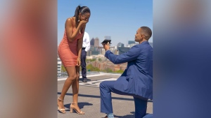 William Hunn proposes to Brittney Miller with five engagement rings in downtown Atlanta. Image: James D. Love/@jamesdlove