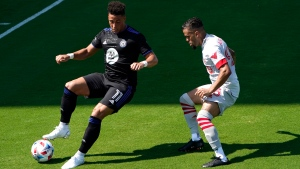 CF Montreal forward Erik Hurtado (11) maneuvers the ball as Toronto FC defender Auro Jr. defends during the second half of an MLS soccer match, Saturday, April 17, 2021, in Fort Lauderdale, Fla. CF Montreal won 4-2. (AP Photo/Lynne Sladky)