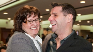 Joanne Marcotte, left, and Eric Duhaime, co-founders of the Reseau Liberte-Quebec, smile at the beginning of a right wing meeting Saturday, October 23, 2010 in Quebec City. On April 17, 2021, Duhaime was elected leader of the Quebec Conservative Party. THE CANADIAN PRESS/Jacques Boissinot