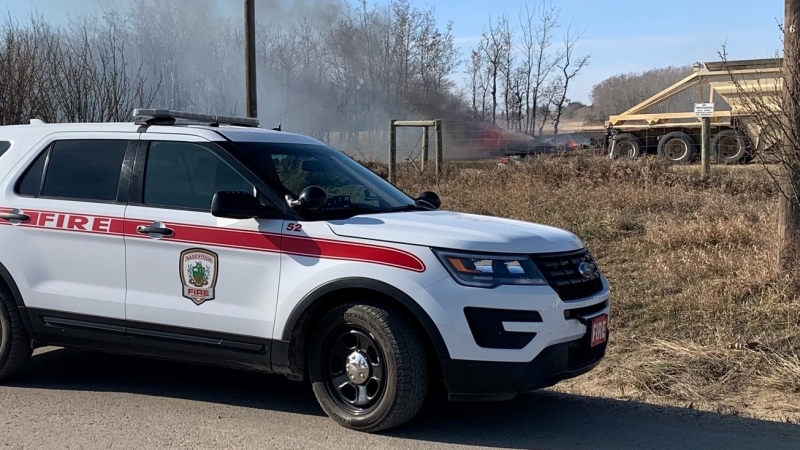 Saskatoon fire crews respond to grass fire on Burma Road, just north of CN Rail Yards Saturday afternoon (Ryan Fletcher/CTV Saskatoon)