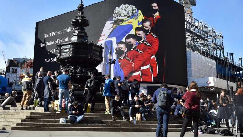 An image of the coffin of Prince Philip is displayed on a giant screen at Piccadilly Circus, London Saturday, April 17, 2021. Prince Philip, husband of Queen Elizabeth II, died Friday April 9 aged 99. His funeral service is taking place at St. George's Chapel inside Windsor Castle Saturday. (AP / Rui Vieira)