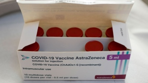 A box with vials of AstraZeneca vaccine against COVID-19 were taken out of a fridge for a few seconds during a vaccination campaign in Amsterdam, Netherlands, Wednesday, April 14, 2021. (AP Photo/Peter Dejong)
