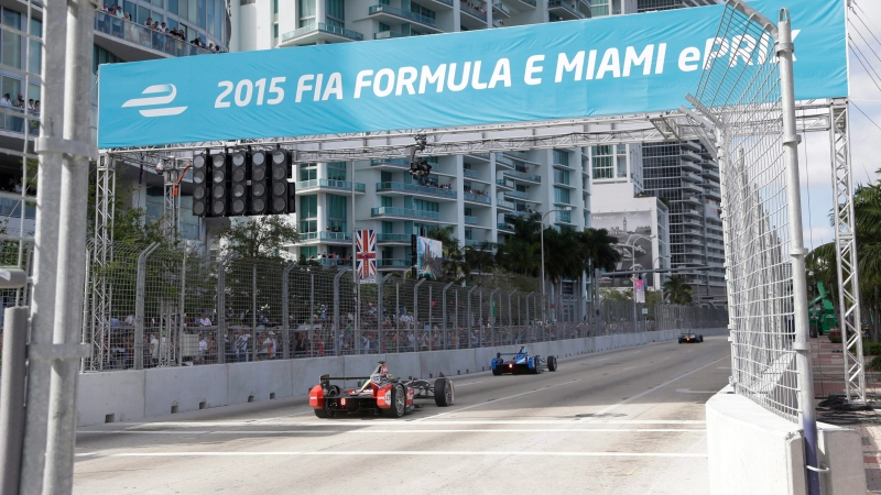 In this March 14, 2015, file photo, cars race on downtown Miami streets during the Formula E Miami ePrix auto race, in Miami. Formula One has announced plans for a street race in Miami starting in 2019. Miami city officials are scheduled to vote next week on a plan to stage a race the series has long coveted as it seeks to enlarge its presence in the United States. A Miami race would be the second in the U.S., joining the U.S. Grand Prix in Austin, Texas. (AP Photo/Wilfredo Lee, File)