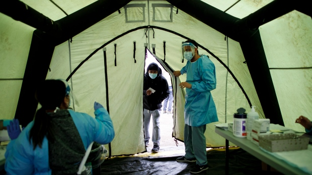A man enters a tent at a pop-up vaccine clinic in Toronto's Jane and Finch neighbourhood, in the M3N postal code, on Saturday, April 17, 2021. THE CANADIAN PRESS/Cole Burston