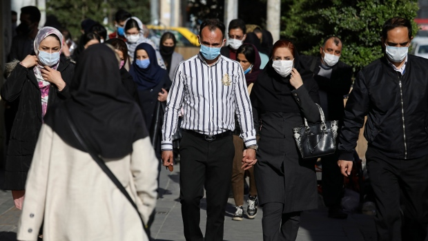 FILE - In this April 5, 2021, file photo, people wearing protective face masks to help prevent the spread of the coronavirus walk in downtown Tehran, Iran. Nations around the world set new records Thursday, April 8, for COVID-19 deaths and new coronavirus infections, and the disease surged even in some countries that have kept the virus in check. (AP Photo/Vahid Salemi, File)