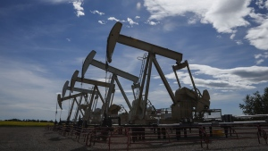 Pumpjacks draw oil out of the ground near Olds, Alta., on July 16, 2020. THE CANADIAN PRESS/Jeff McIntosh