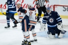 Edmonton Oilers' Jesse Puljujarvi (13) and Leon Draisaitl (29) celebrates Puljujarvi's goal against Winnipeg Jets goaltender Connor Hellebuyck (37) during third period NHL action in Winnipeg on Saturday, April 17, 2021. THE CANADIAN PRESS/John Woods