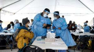 Healthcare workers prepare to administer a Moderna COVID-19 vaccine at a pop-up clinic in Toronto's Jane and Finch neighbourhood, in the M3N postal code, on Saturday, April 17, 2021. Despite rates of COVID-19 deaths and hospitalizations far exceeding other areas of the city, residents of the M3N postal code continue to struggle with the lowest vaccination rates in Toronto. THE CANADIAN PRESS/Cole Burston